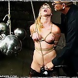 Submissive Crystal Rayne is forced to endure pussy weights, strict bondage, and harsh caning before being allowed to orgasm.