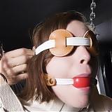 Brunette in institutional restraints recieves theraputic orgasms