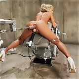 Blond babe fucked by sci-fi machines, cums uncontrollably in bondage.