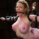 Big titted flexible blond, is bound and suspended in a custom bondage device! Great breast and nipple torture.